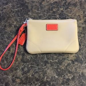 Coach wristlet with orange detailing